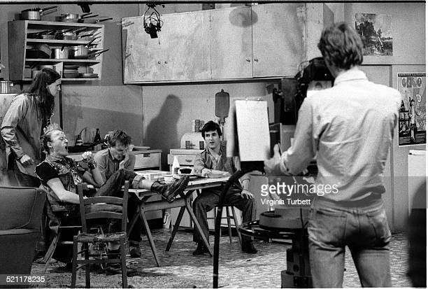 Nigel Planer as Neil Adrian Edmondson as Vyvyan Rik Mayall as Rick and Chris Ryan as Mike on set in front of a BBC cameraman during the filming of...