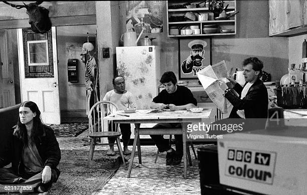 Nigel Planer as Neil David Rappaport Chris Ryan as Mike and Rik Mayall as Rick on set in front of the BBC cameras during the filming of The Young...