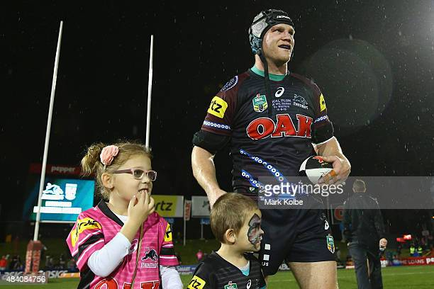 Nigel Plum of the Panthers celebrates with his family after playing his 150th NRL match during the round 23 NRL match between the Penrith Panthers...