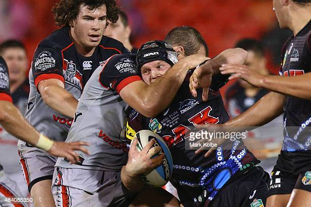 Nigel Plum of the Panthers is tackled during the round 23 NRL match between the Penrith Panthers and the New Zealand Warriors at Pepper Stadium on...
