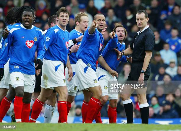 Nigel Quashie and Eyal Berkovic of Portsmouth with their team mates appeal to the referee Mr D Messias after he gives a penalty during the FA Cup...