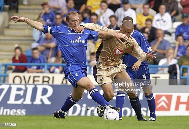 Nigel Quashie of Portsmouth holds off Paul Smith of Gillingham during the Nationwide Division One match between Gillingham v Portsmouth at the...