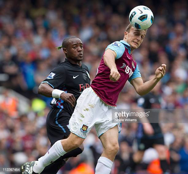 Nigel Reo Coker of Aston Villa is challenged by Mark Noble of West Ham United during the Barclays Premier League match between West Ham United and...