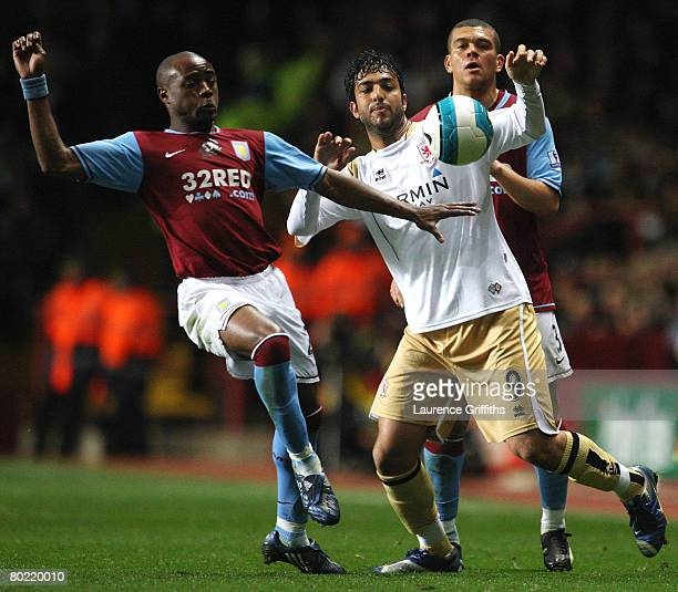 Nigel ReoCoker of Aston Villa battles with Mido of Middlesbrough during the Barclays Premier League match between Aston Villa and Middlesbrough at...