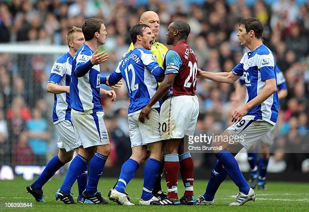 Nigel Reo-Coker of Aston Villa clashes with Barry Ferguson of Birmingham City after he appeared to kick Craig Gardener during the Barclays Premier...