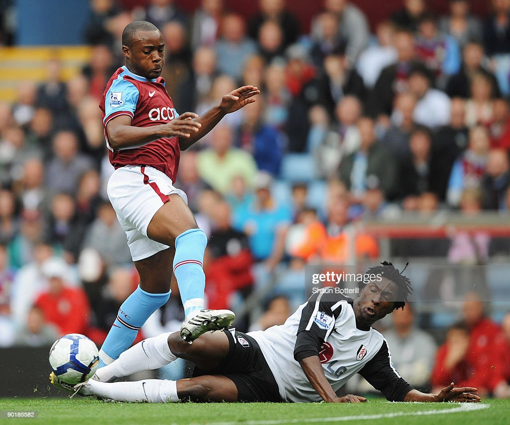 Nigel Reo-Coker of Aston Villa is tackled by Dickson Etuhu of Fulham during the Barclays Premier League match between Aston Villa and Fulham at Villa Park on August 30, 2009 in Birmingham, England.