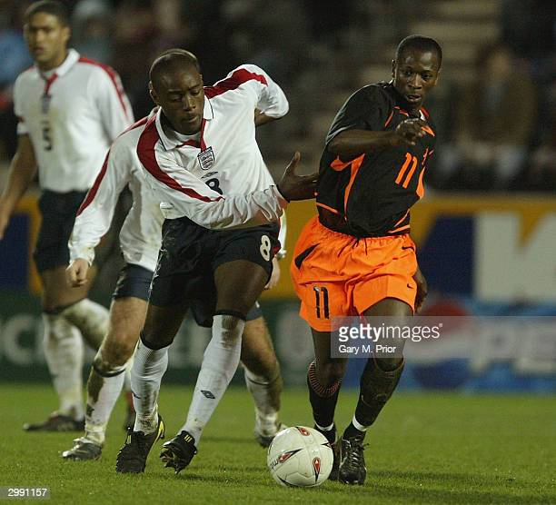 Nigel ReoCoker of England clashes with Romeo Castelen of Holland during the U21's match between England and Holland at the Kingston Communications...