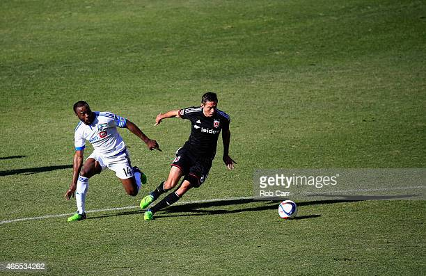 Nigel ReoCoker of Montreal Impact and Davy Arnaud of DC United go after the ball during the first half at RFK Stadium on March 7 2015 in Washington DC