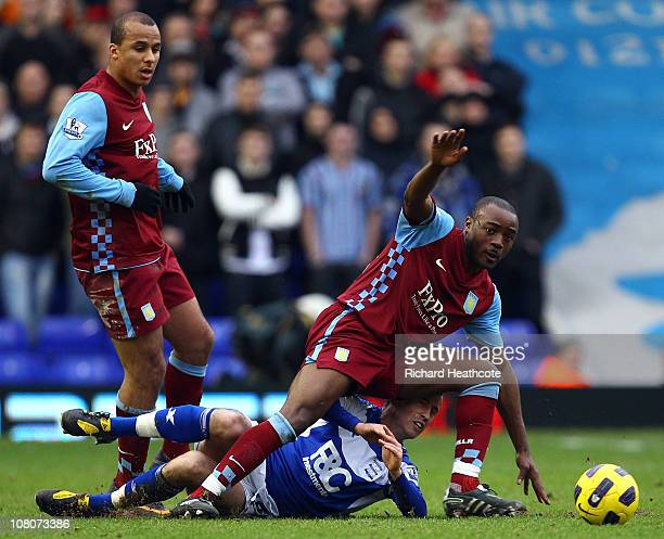 Nigel ReoCoker of Villa rides a challenge from Keith Fahey of Birmingham during the Barclays Premier League match between Birmingham City and Aston...