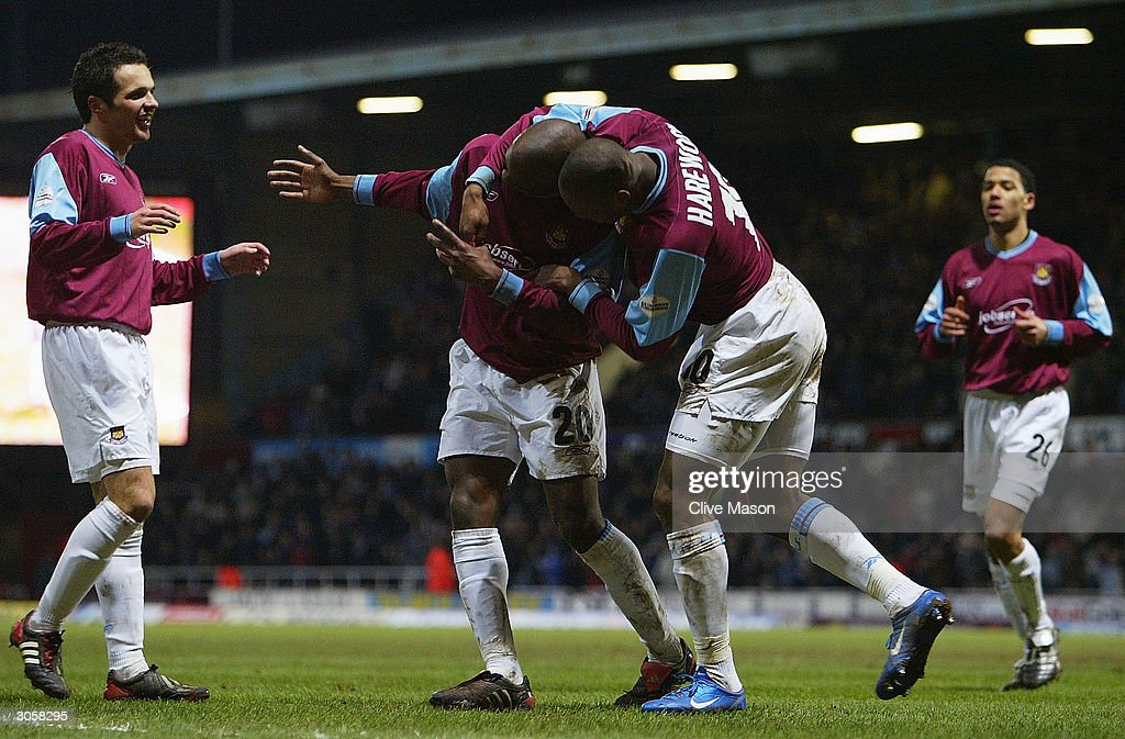 Nigel Reo-Coker of West Ham is congratulated by Marlon Harewood after scoring during the Nationwide Division One match between West Ham United and Wimbledon at Upton Park on March 9, 2004 in London.