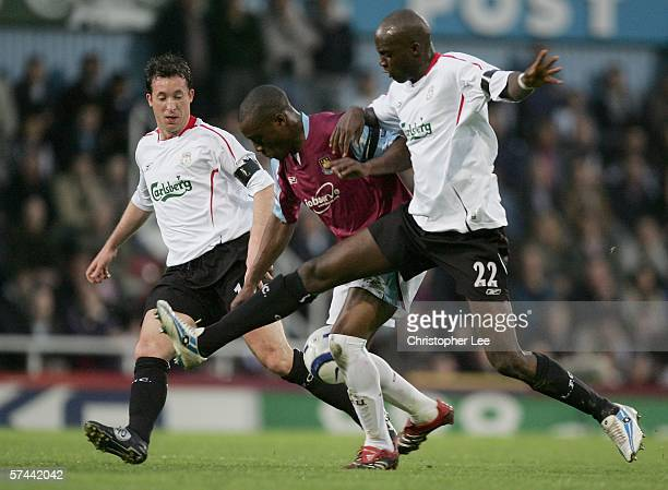 Nigel ReoCoker of West Ham United goes between Mohamed Sissoko and Robbie Fowler of Liverpool during the Barclays Premiership match between West Ham...