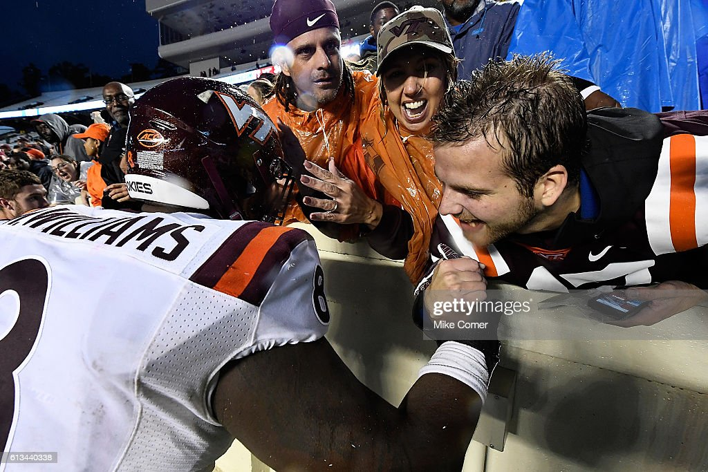Nigel Williams #8 of the Virginia Tech Hokies celebrates with Hokie fans at Kenan Stadium following the a victory against the UNC Tar Heels on October 8, 2016 in Chapel Hill, North Carolina.