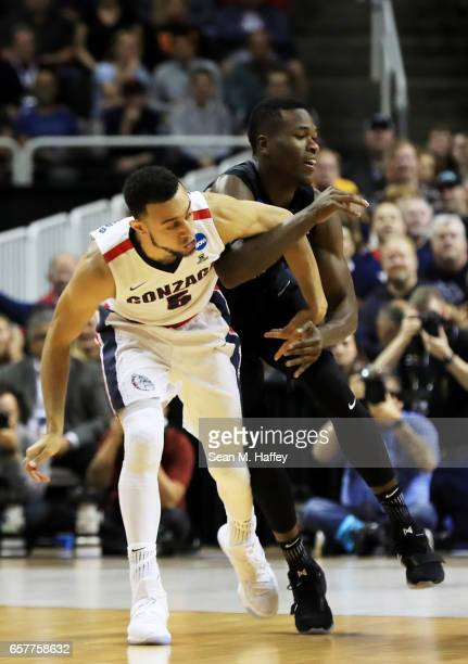 Nigel WilliamsGoss of the Gonzaga Bulldogs and Malcolm Bernard of the Xavier Musketeers get tangled up in the first half during the 2017 NCAA Men's...