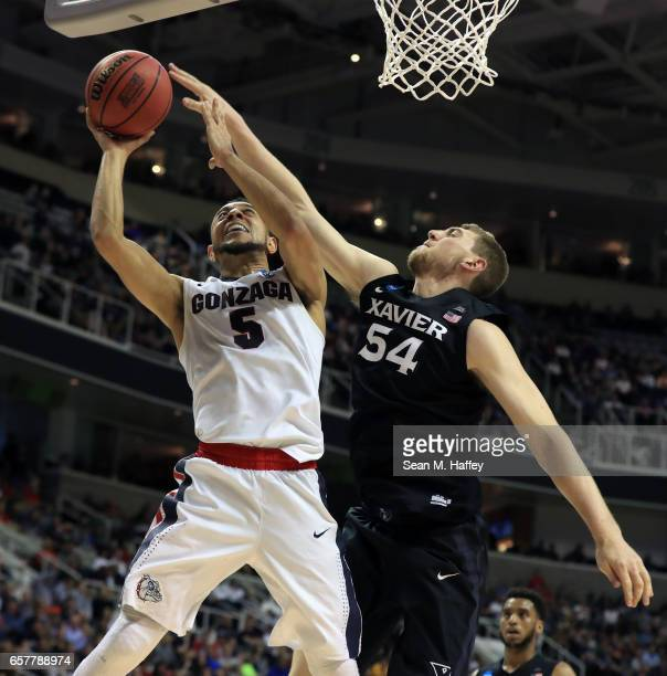 Nigel WilliamsGoss of the Gonzaga Bulldogs attempts a shot defended by Sean O'Mara of the Xavier Musketeers during the 2017 NCAA Men's Basketball...