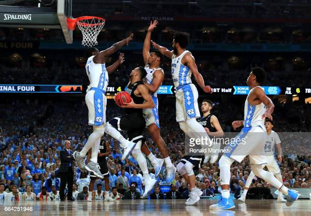 Nigel WilliamsGoss of the Gonzaga Bulldogs drives to the basket against Theo Pinson of the North Carolina Tar Heels in the first half during the 2017...