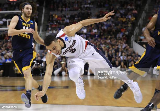 Nigel WilliamsGoss of the Gonzaga Bulldogs falls to the ground against the West Virginia Mountaineers during the 2017 NCAA Men's Basketball...