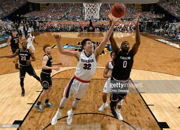Nigel WilliamsGoss of the Gonzaga Bulldogs gets denied by Hassani Gravett of the South Carolina Gamecocks during the 2017 NCAA Men's Final Four...