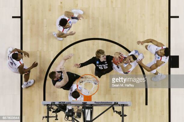Nigel WilliamsGoss of the Gonzaga Bulldogs goes up against JP Macura of the Xavier Musketeers during the 2017 NCAA Men's Basketball Tournament West...