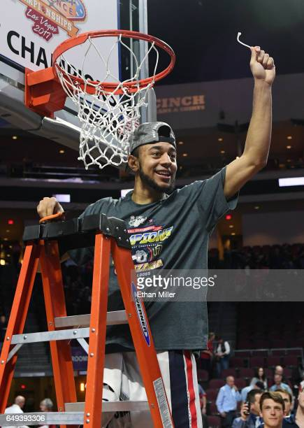 Nigel WilliamsGoss of the Gonzaga Bulldogs reacts after cutting down a piece of a net after defeating the Saint Mary's Gaels 7456 in the championship...