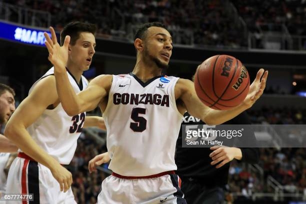 Nigel WilliamsGoss of the Gonzaga Bulldogs rebounds against JP Macura of the Xavier Musketeers in the first half during the 2017 NCAA Men's...