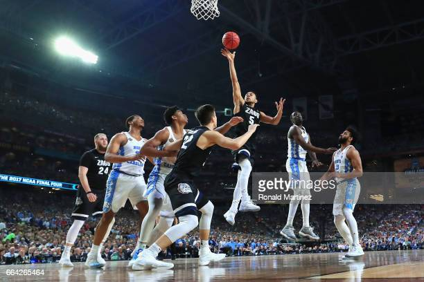 Nigel WilliamsGoss of the Gonzaga Bulldogs shoots against Isaiah Hicks of the North Carolina Tar Heels in the second half during the 2017 NCAA Men's...