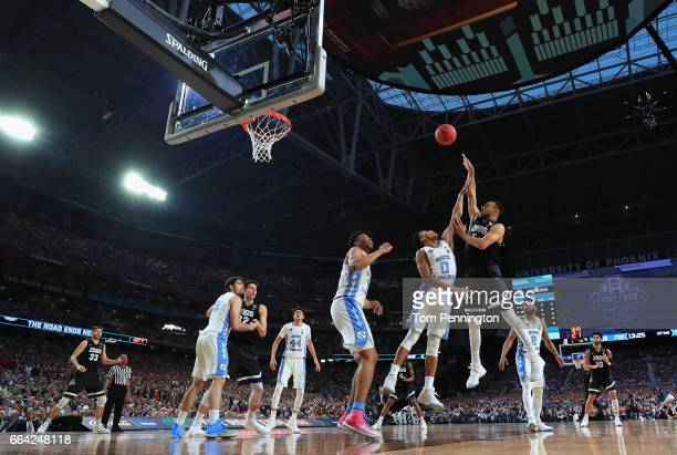 Nigel WilliamsGoss of the Gonzaga Bulldogs shoots against Nate Britt of the North Carolina Tar Heels in the first half during the 2017 NCAA Men's...