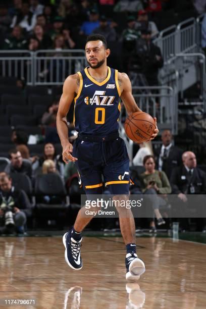 Nigel WilliamsGoss of the Utah Jazz dribbles up court against the Milwaukee Bucks on October 9 2019 at the Fiserv Forum Center in Milwaukee Wisconsin...