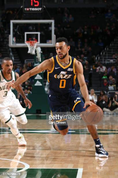 Nigel WilliamsGoss of the Utah Jazz drives to the basket against the Milwaukee Bucks on October 9 2019 at the Fiserv Forum Center in Milwaukee...