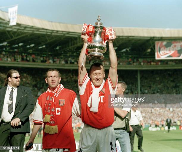 Nigel Winterburn of Arsenal watches as team mate Lee Dixon celebrates with the FA Cup after their victory over Newcastle United in the FA Cup Final...