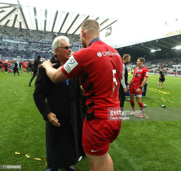 Nigel Wray the Saracens owner celebrates with George Kruuis after their victory during the Champions Cup Final match between Saracens and Leinster at...