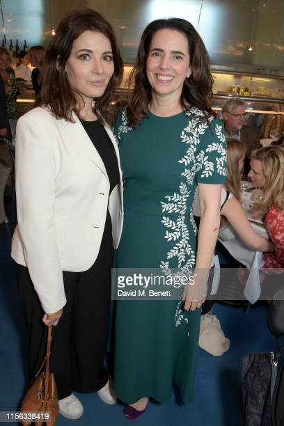 Nigella Lawson and Amelia Mendoza attend The Sunday Times AA Gill Award for emerging food critics at The River Cafe on June 16 2019 in London England
