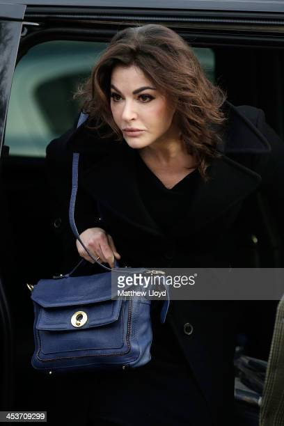Nigella Lawson arrives at Isleworth Crown Court on December 5 2013 in Isleworth England Italian sisters Francesca and Elisabetta Grillo who worked as...