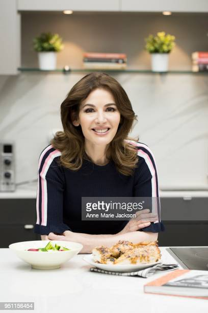 Nigella Lawson in the test kitchen with Karon Liu the Toronto Star's resident food writer making sesame roasted chicken from her new cookbook At My...