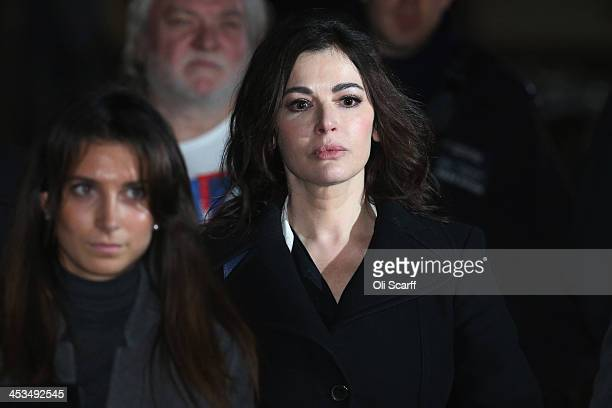 Nigella Lawson leaves Isleworth Crown Court on December 4 2013 in London England Italian sisters Francesca and Elisabetta Grillo who worked as...