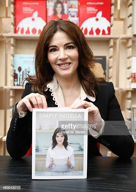 Nigella Lawson poses with her book 'Simply Nigella' during day three of Stylist Magazine's first ever 'Stylist Live' event at the Business Design...