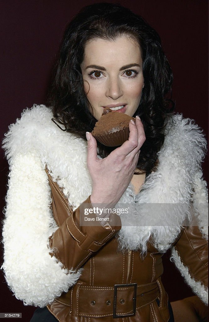 Nigella Lawson unveils her chocolate double at Selfridges to be auctioned in aid of Barnardos on December 7, 2003 in London.