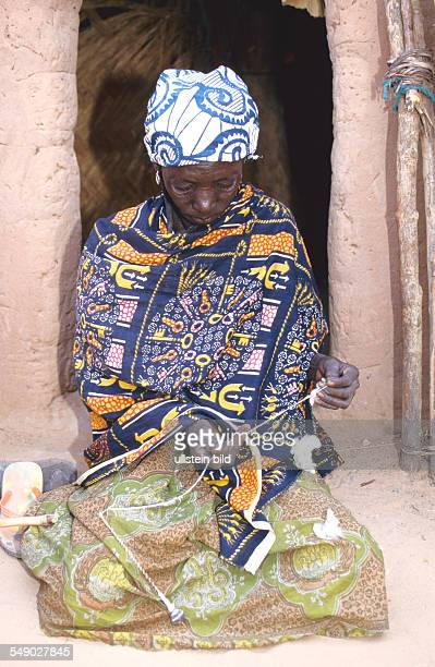 A Hausa woman spinning cotton