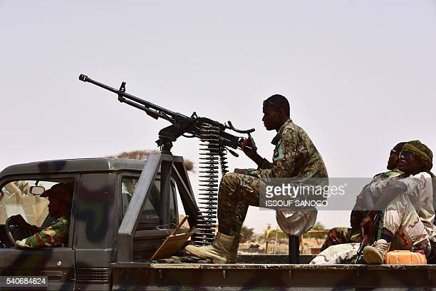 Niger Army armed forces patrol during a visit of Niger's Interior Minister to a camp for displaced populations near Diffa on June 16 2016 following...