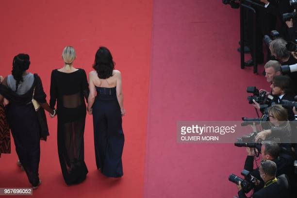 Niger director Rahmatou Keita, French actress Marion Cotillard and French director Vanessa Filho walk the red carpet in protest of the lack of female...
