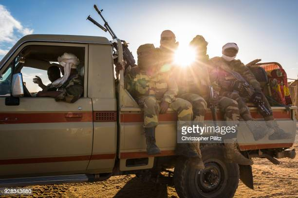 A Niger military unit on patrol in Sahara desert.