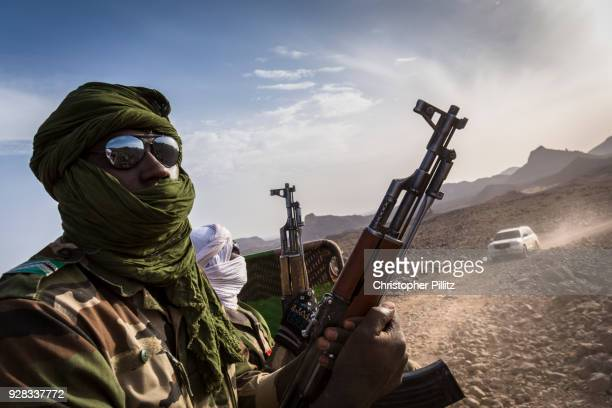 Niger army unit travels in convoy with the mayor of Agadez city, Rhissa Feltou and his entourage into the Aïr mountains from the Tidene region of...