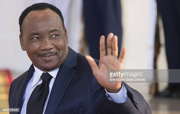 Niger President Issoufou Mahamadou arrives at the White House for a group dinner during the US Africa Leaders Summit August 5 2014 in Washington DC...