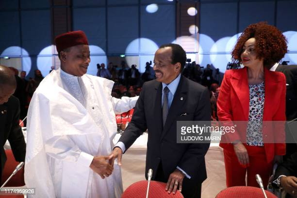 Niger president Mahamadou Issoufou, Cameroon president Paul Biya and his wife Chantal arrive on the second day of the conference of Global Fund to...