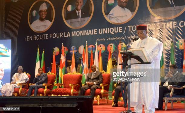 Niger President Mahamadou Issoufou delivers a speech on October 24 2017 at the opening of a summit of heads of state of the Economic Community of...
