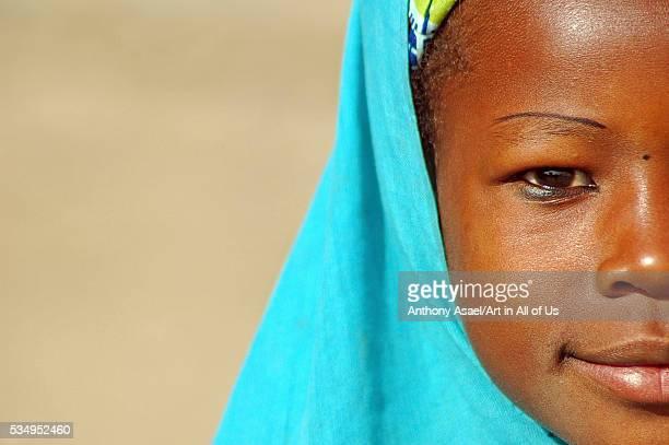 Niger Zinder Detail portrait of an african muslim girl wearing a turquoise tchador Zinder Niger