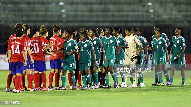 Nigeria and Korean Republic players shake hands after the FIFA U-20 Women's World Cup Japan 2012, Group B match between Nigeria v Korean Republic at...