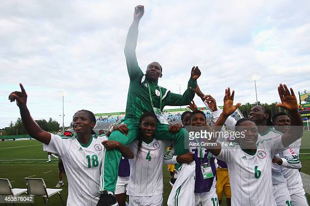 Nigeria head coach Peter Dedevbo Asisat Oshoala and team mates celebrate after the FIFA U20 Women's World Cup Canada 2014 Semi Final match between...