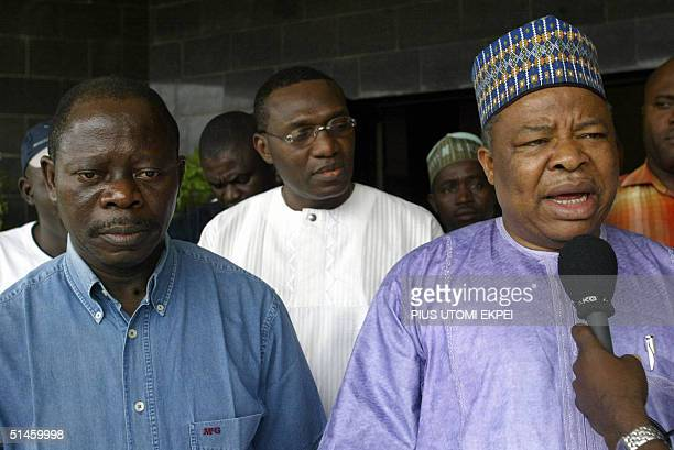 Nigeria Labour Congress President Adams Oshiomhole listens as Deputy President of the Senate Ibrahim Mantu speaks at the Abuja Labour headquater on...