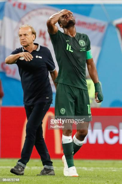 Nigeria national team head coach Gernot Rohr and John Obi Mikel react after the 2018 FIFA World Cup Russia group D match between Nigeria and...