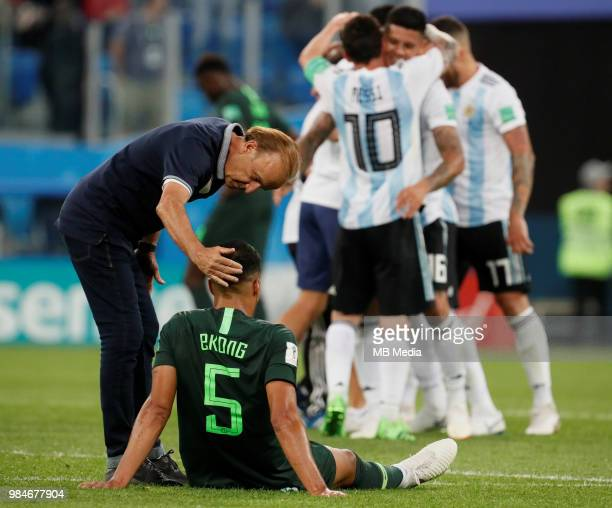 Nigeria national team head coach Gernot Rohr and William Ekong are seen as Argentina national team players celebrate victory during the 2018 FIFA...